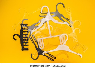 Scattered hangers on yellow background