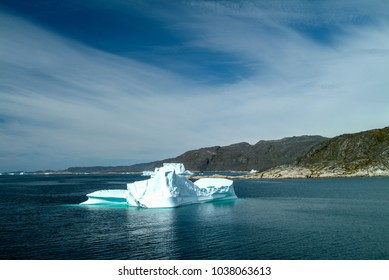 Scattered icebergs in the Arctic Ocean fjord between Qaqortoq and Hvalsey on the west coast of Greenland