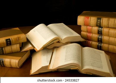 Scattered law books being used for research.