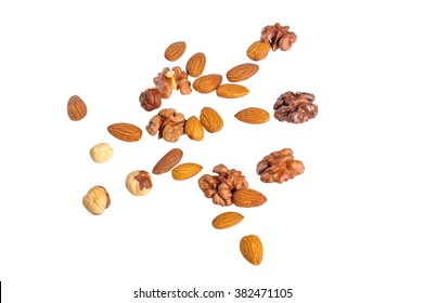 Scattered nuts. Isolated on white
