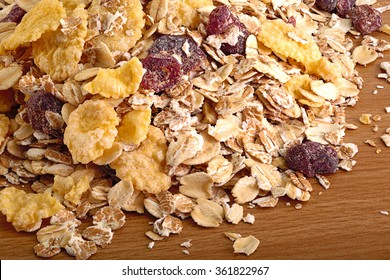 scattered on the wooden table of muesli