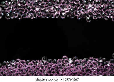 Scattered pink crystals arranged in two horizontal bands with copyspace for text in the middle
