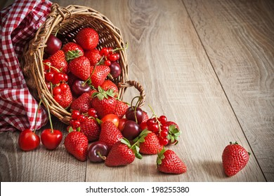 Scattered ripe summer berries from basket