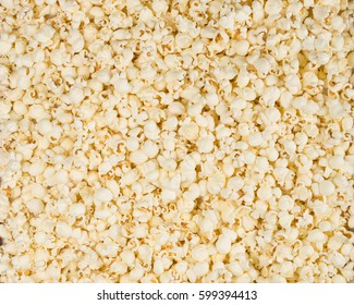 Scattered salted popcorn, texture background.