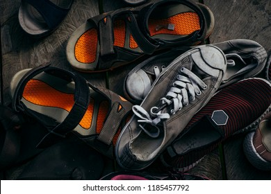 scattered of shoes and sandal on wooden floor