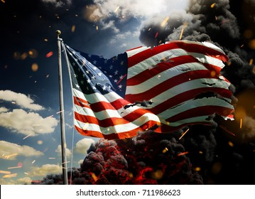 Scattered USA flag in smoke and fire