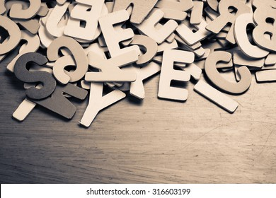 Scattered wood letters on wood table