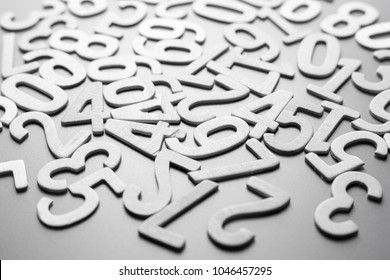 Scattered wood numbers on the table for mathematics concept