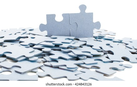 Scattered wooden puzzle pieces isolated on white background
