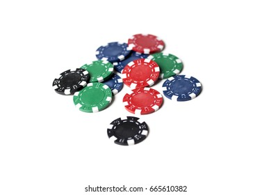 A scattering of assorted coloured gaming chips isolated against a white background