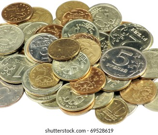 scattering of coins close up on white background