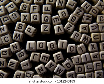 scattering of cubes with letters, forming the word LOGIC