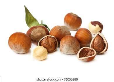 Scattering of garden hazelnuts on a white background.