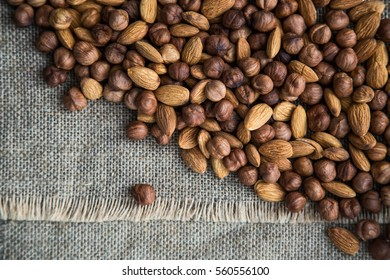 scattering a pile of nuts on burlap cloth