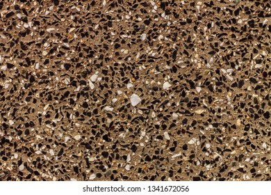 a scattering of small stones on the surface, this decoration of the facade of the building wall will be a good choice of building designers
