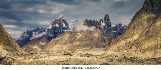 Scectacular peaks of Trango Towers in Karakoram Mountain Range, Pakistan with Baltoro glacier down in the valley.