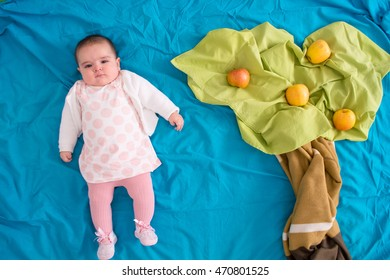 Scenario with a baby and an apple tree