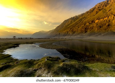 Scenary of Sunset at Nubra is a tri-armed valley located to the north east of Ladakh valley. Diskit the capital of Nubra is about 150 km north from Leh town