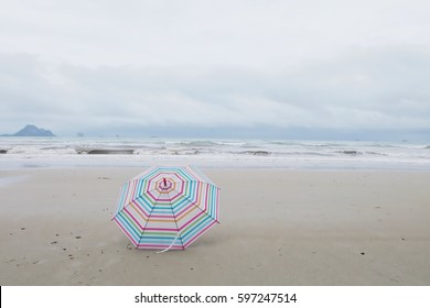 Scene from Beach at Gulf Shores, Alabama,umbrella, at end of summer with Life Guard Stand.