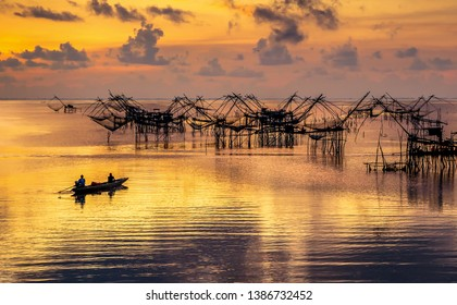 Scene of beautiful sunrise in the morning and giant square dipnet at Pakpra village, Phatthalung, Thailand