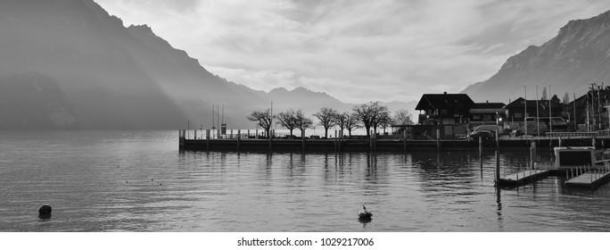 Scene in Brienz, Switzerland. Lake Brienzersee and mount Augstmatthorn. Quai.