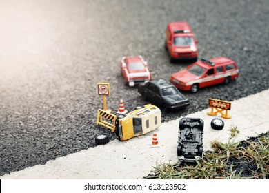 Scene of cars (miniature, toy model ) accident on street.Insurance concept.