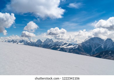 Scene with climbers going down the snow slope of the highest peak in Europe - mount Elbrus
