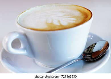 scene close-up details and cup of coffee with milk and cream