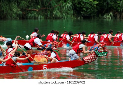 Scene of a competitive boat racing in the Dragon Boat Festival in Taipei, Taiwan, where the women athletes pull vigorously on the oars and compete with all their strength in traditional dragon boats