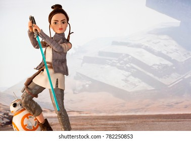 Scene depicting Rey discovering the force wielding a lightsaber while training as a Jedi with the droid BB-8 - Hasbro Forces of Destiny action figure