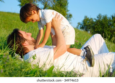 Scene of family happiness on beautiful green meadow