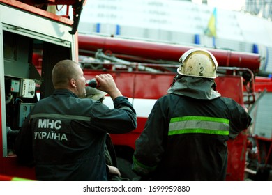 At the scene of a fire in a building. Firefighters Work Concept. Dnipro / Ukraine - 08.10.2010