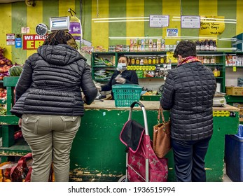 The scene in a food store, line to cashier, maintained social distance, Bronx, New York, United States, 3.15.2021