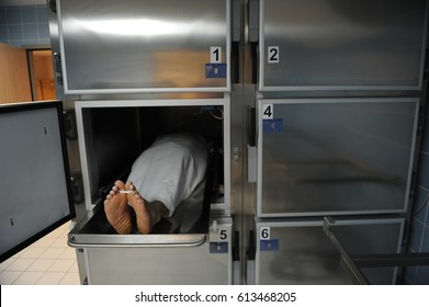 A scene in the hospital morgue, where the corpses were taken after he died.