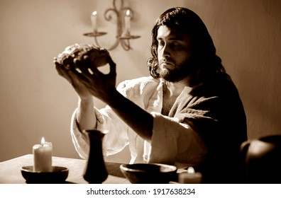 Scene, of Jesus Christ blessing the bread and wine during the last supper with his apostles. Sepia tones.