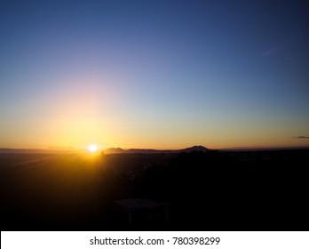 A scene of morning sun seeing from Mibu, Tochigi, Japan in December, 2017.