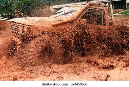 Scene of mud splash in off-road racing.
