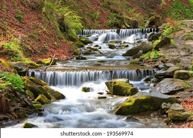 Scene with nice cascade on mountain river