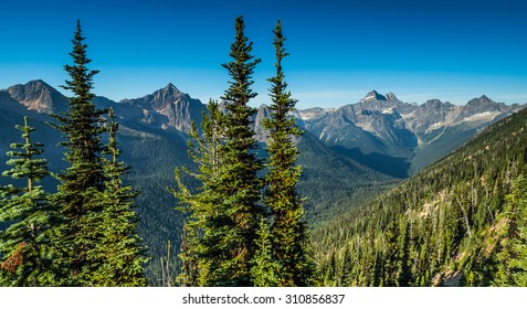 A scene of the North Cascades mountain range as seen from the Pacific Crest Trail in northern Washington