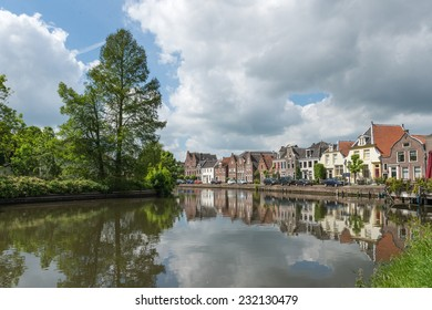Scene of the old dutch village Maarssen with characteristic houses.River Vecht running through the village.