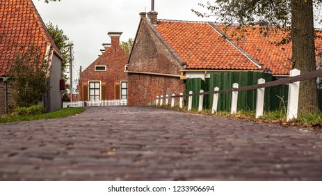 Scene from old heritage town white typical Dutch architecture from a bygone era and authentic details.