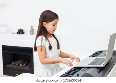 Scene of piano lessons online training or E-class learning while Coronavirus spread out or covid-19 crisis situation, vlog or teacher make online piano lesson to teach students pupils learn from home.