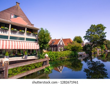 Scene from picturesque cheese-making town of Edam, Holland with historic architecture and canal