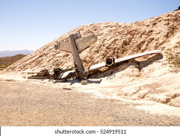 Scene of a plane crash in desert landscape
