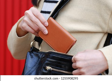 a scene of putting a wallet in a bag