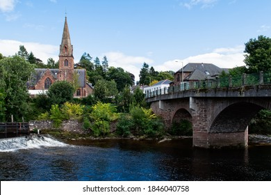 Scene at the river in Blairgowrie in Scotland. Blairgowrie Bridge, the Riverside Methodist Church and River Ericht