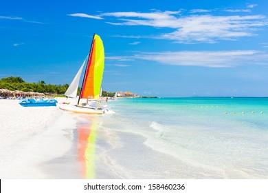 Scene with sailing boat at the famous Varadero beach , Caribbean sea in Cuba