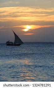 scene with sailing ship on sunset sea