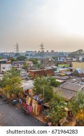 A scene at slum area with tiny houses built-in for living with sunset in the background,Adyar,Chennai,India,May 20 2017