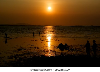 Scene of summer time, Silhouette people on beach with sunset sky at sea